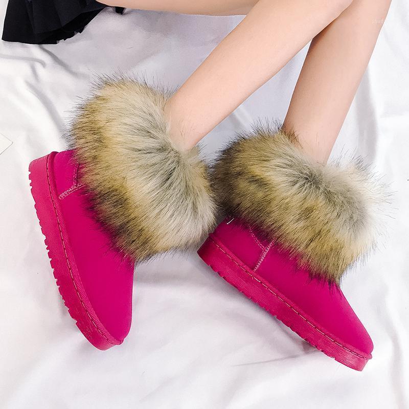 Invierno Mujeres cálidas Piel Zapatillas de nieve Pisos Tobillo Botas de nieve Mujeres 2020 Negro Redondo Toe Casual Slip On Ladies Winter Boots1