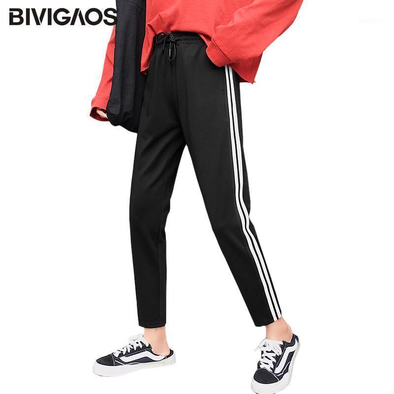 Bivigaos Новые полосатые спортивные брюки женские спортивные штаны Дышащие высокие талии брюки Drawstring Случайные брюки Дамы Harajuku1