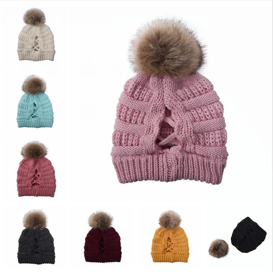 Frauen Pompom Mütze Kreuz Criss Ponytail Hut Mädchen Warm Ski-Kappe Winter Weiche Knit Unordentlicher Bun Mütze Meer Versand DDA631