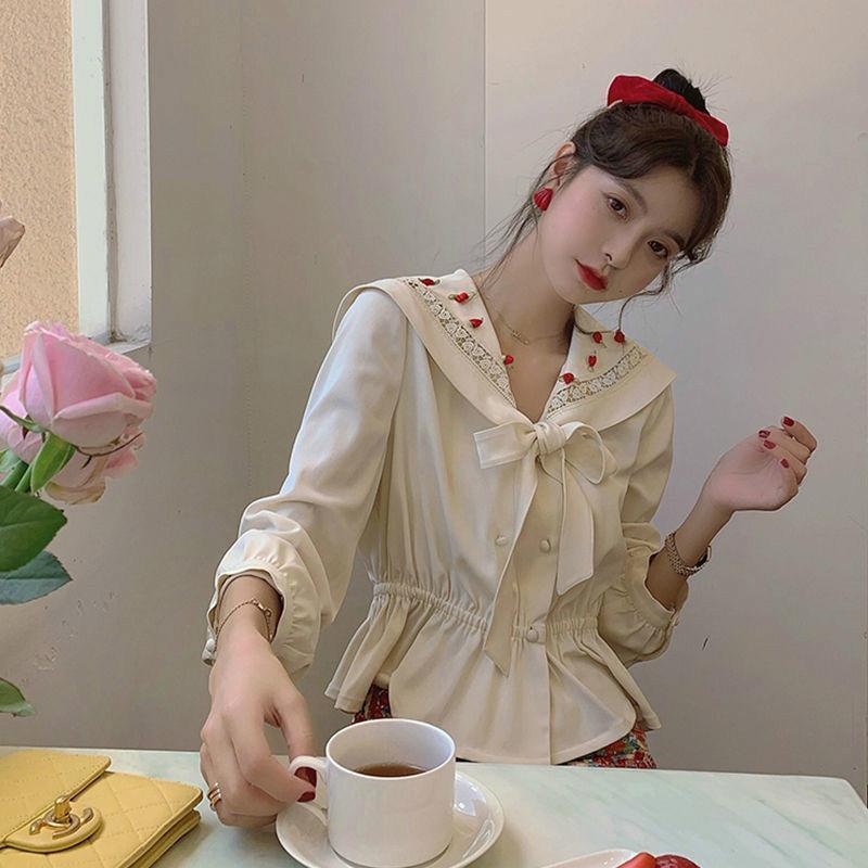 2021 Nuevo primavera otoño mujeres elegante linterna manga elástica alta cintura blusa dama sexy arco corbata v cuello camisa suelta irregular A59