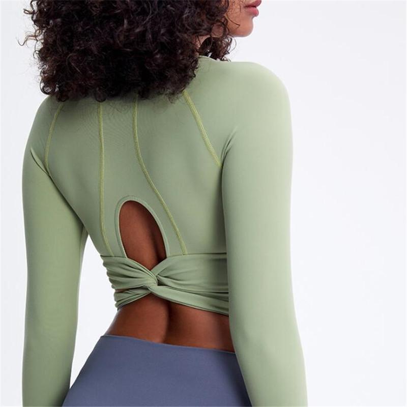 Trajes de yoga Mujeres Nylon Fitness camisetas Atrás Atrás Anti-Sweat Gimnasio Entrenamiento Deporte Camiseta de manga larga Tops de manga larga con agujeros de pulgar
