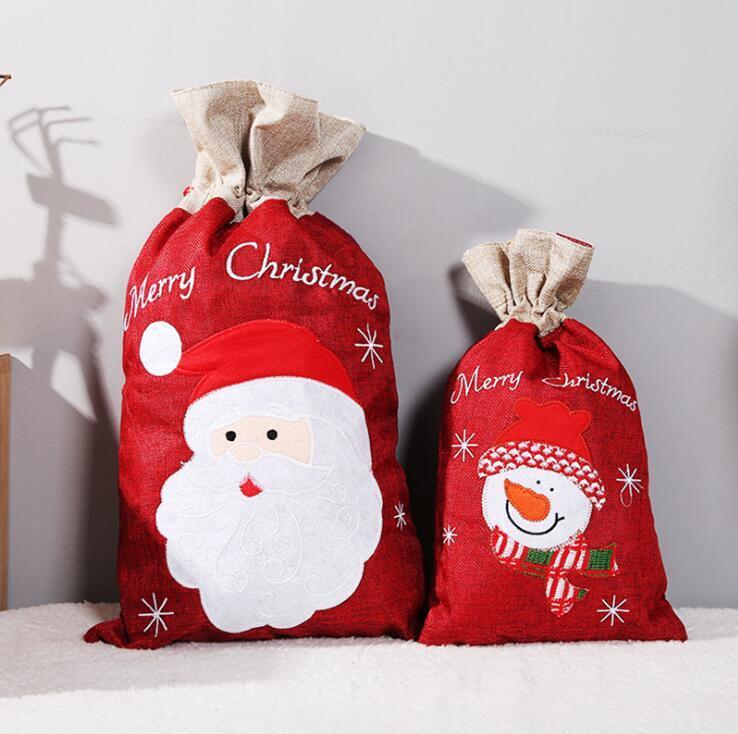 Packs de Navidad regalo de Santa Claus bolsa de Santa muñeco de nieve Saco de Apple de caramelo bolsa de almacenamiento de ropa Bolsas de regalo de Navidad con cordón decoraciones de Navidad YL632