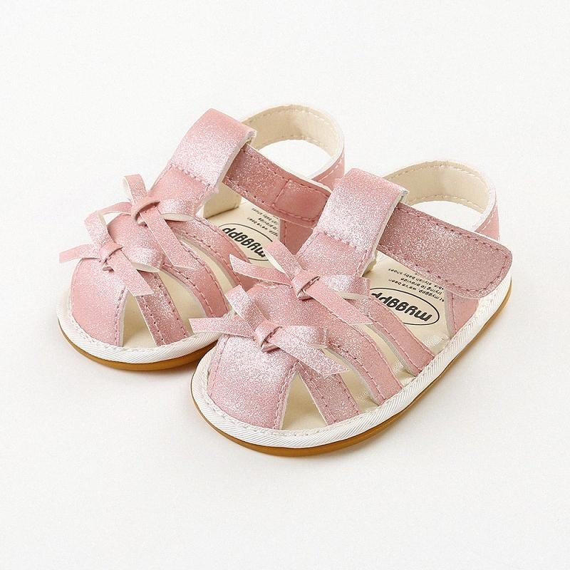 Nuova estate del bambino Sandali in pelle PU ragazze scarpe arco della Croce Lace Up Sandali Hook Loop Bow comodo hard Sole Bambino 9A8R #