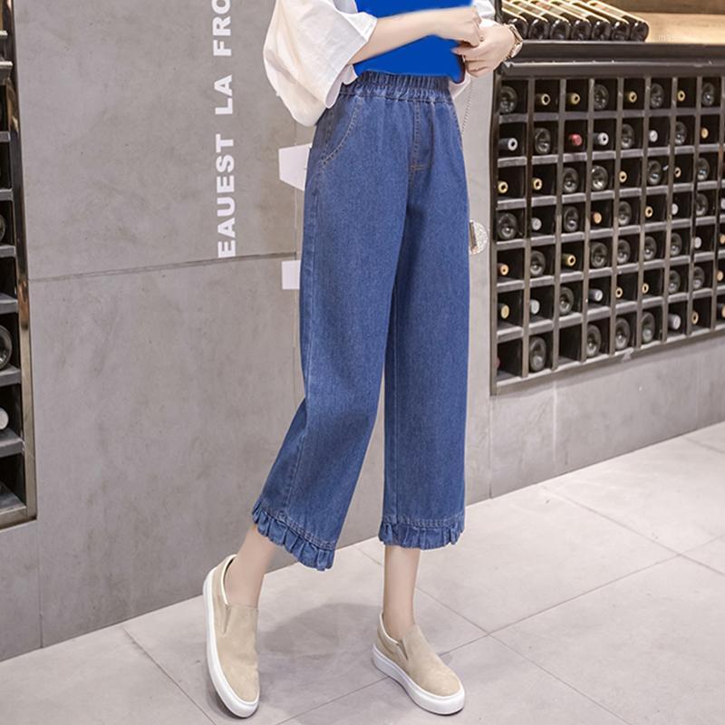 Женский большой размер джинсы весны и лето Новый Большой размер Семь точечные джинсы женские 100 кг вскользь широко-ноги Tide1