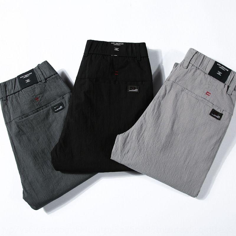 вскользь вскользь Мужская универсальная упругая пружина молодежными тонкие ноги Корейский стиль упругие талии брюки мужские брюки foCRX