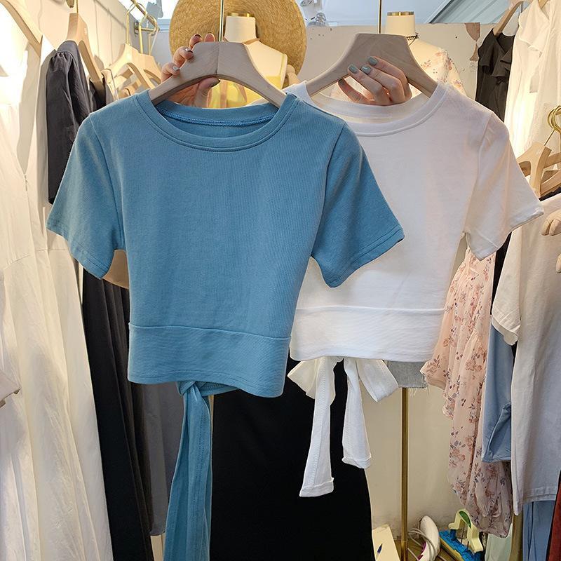 Corea del Sur 2021 Verano Nueva versión coreana Versátil Sólido Cuello redondo Mostrar Thin Back Tie Pullover Camiseta de manga corta para mujer