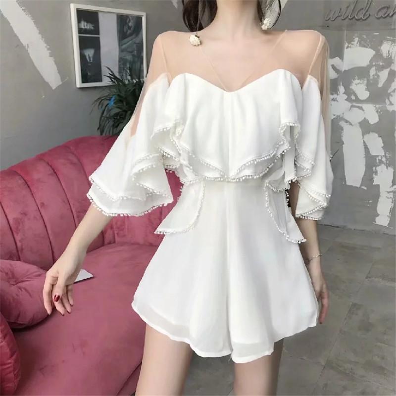 Mode Sexy Blanc Jumpsuit 2020 Été col en V transparent de l'épaule Mini Salopette volantée Layered jambe large Pantalon barboteuses