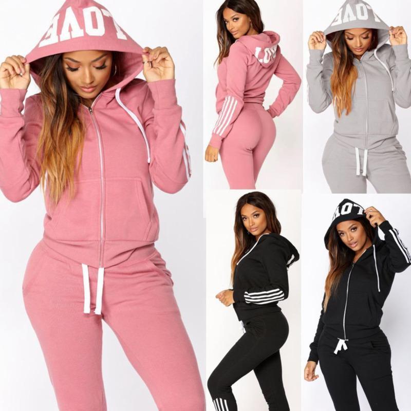 Moda Mujeres 2 piezas Set Tacksuit Casual Letters Sólido Impreso Cinta con capucha Capucha Abrigo Largos Pantalones Trajes Damas Sportswear Nuevo