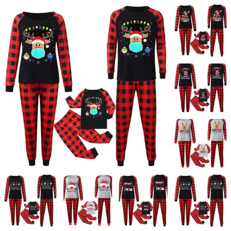 Buffalo Plaid Abiti di Natale Pigiama Set Famiglia Corrispondenza 2020 2021 Maschera Renna Santa Claus Blusa e Pantaloni Home Night Vestiti E110301