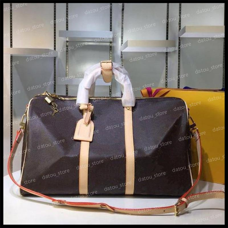 Duffle Bag Men Women النساء المصممين مصممون 2020 أزياء السفر الأمتعة حمل حقيبة الكتف حقائب اليد ذات سعة كبيرة المحافظ المرأة حقيبة الظهر