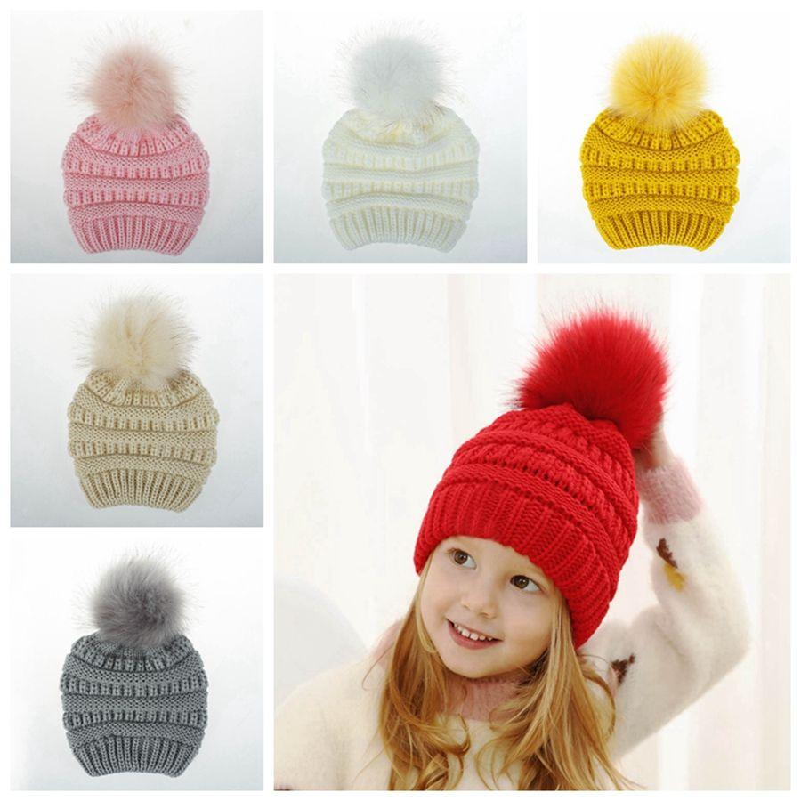 Kind-Winter-Pompom Hut-Kind gestrickte Wollmütze Warm Baby Hat 10.04 Mädchen-Jungen-Außen Wolle Skullies DDA767