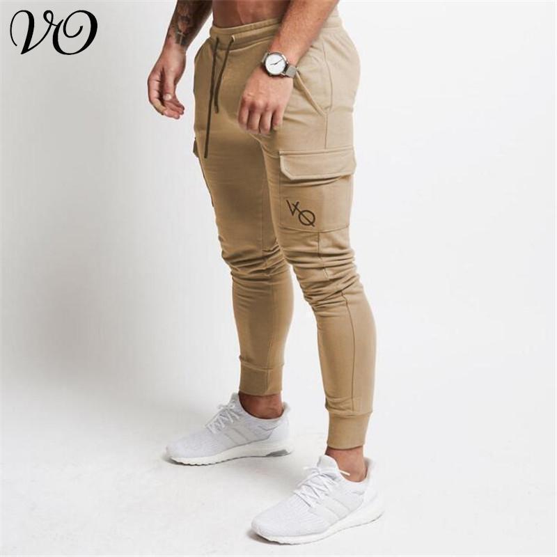 Мужские штаны осенью стиль многокарманский хлопок модные брюки спортивные залы фитнес мужские спорты вышитые бодибилдинг одежда1