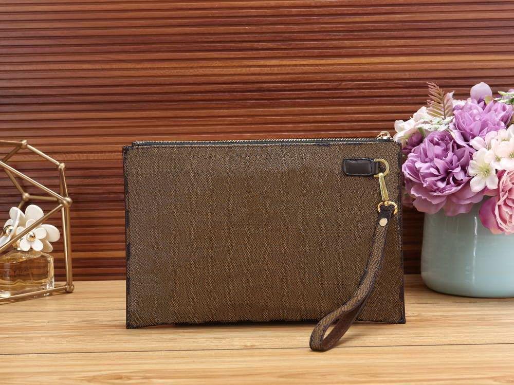 높은 품질의 새로운 핸드 가방 여행 화장품 파우치 29cm 보호 메이크업 클러치 여성 가죽 방수 화장품 가방 중 먼지 가방