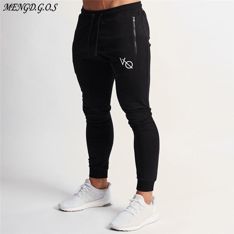 Jogger Brand Sportswear Pantaloni di moda in cotone Streetwear Streetwear Casual Mens Abbigliamento Abbigliamento Allenamento Pantaloni da allenamento 1110