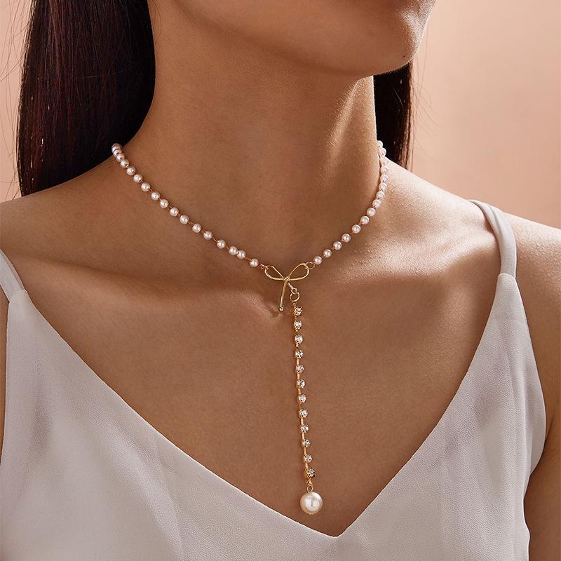 10 pz / lotto Golden Bow Pearl Pendants Moda classica perline collane gioielli per le donne regali del partito