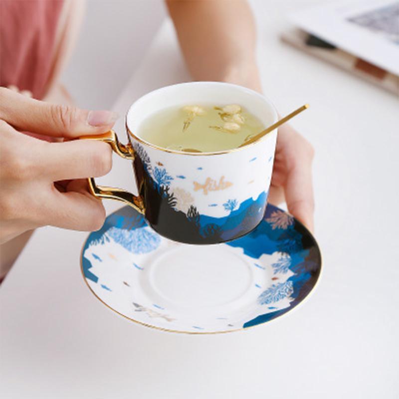 La nueva taza de café de cerámica y platillo conjunto oro Penh Luxury Coffeeware Tree Tea Take With Spoon British StyletaEset 200ml x1027