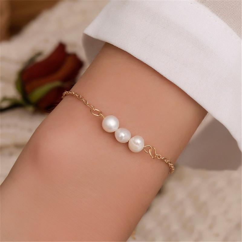 Braccialetto di perle classico semplice coreano braccialetto di perle bianco per donna regolabile romantico accessori per feste di nozze all'ingrosso 2021