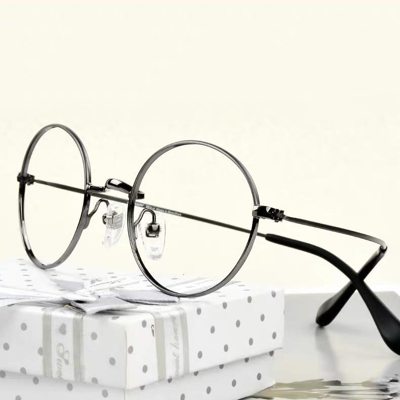 Gafas de titanio completo Pequeñas marcos ópticos redondos hombres y mujeres Marco de vidrio súper ligero EJ3160