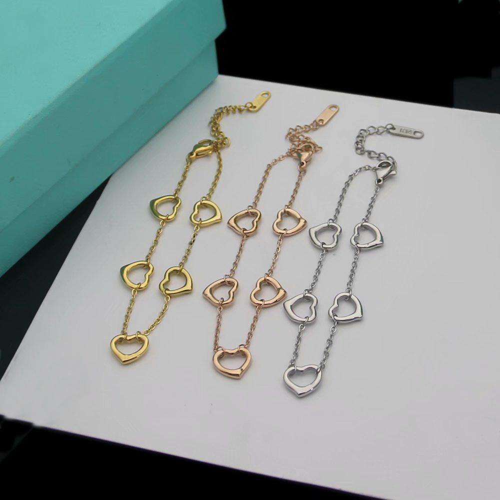 Europa américa estilo moda senhora mulheres titânio bracelete de corrente de aço com oco out t iniciantes cinco pingente de coração 3 cor
