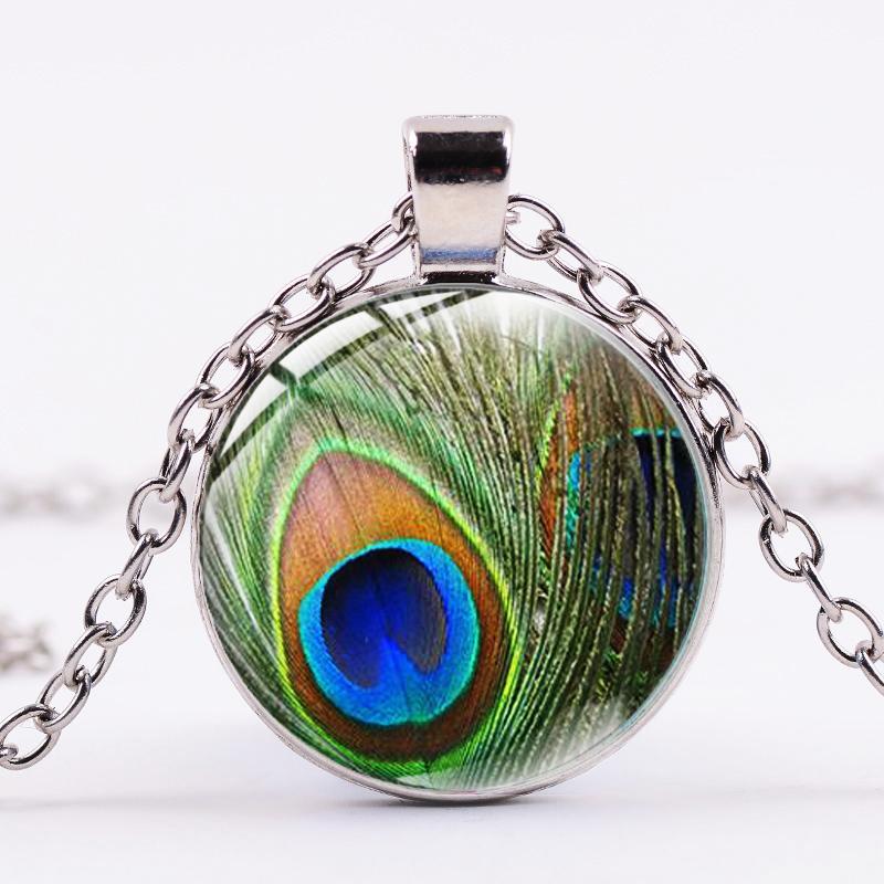 Declaración de la vendimia de la pluma del collar de la joyería clásica verde del pavo real Símbolo Cristal cabujón Arte Collares largos pendientes de Boho