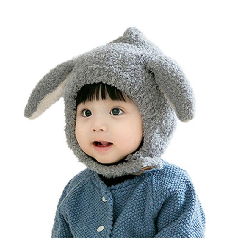 Il nuovo modo del bambino del cappello dei bambini di inverno caldo paraorecchie antivento peluche del bambino Cap 1-2 anni di lana Cappelli