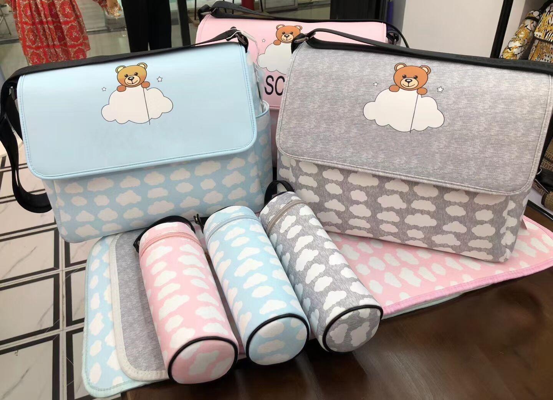 Baby Designer Fralda Bolsas com Interface USB Grande capacidade impermeável Bag Kits Mummy Maternity Bag + Change tapete + suporte de engarrafador