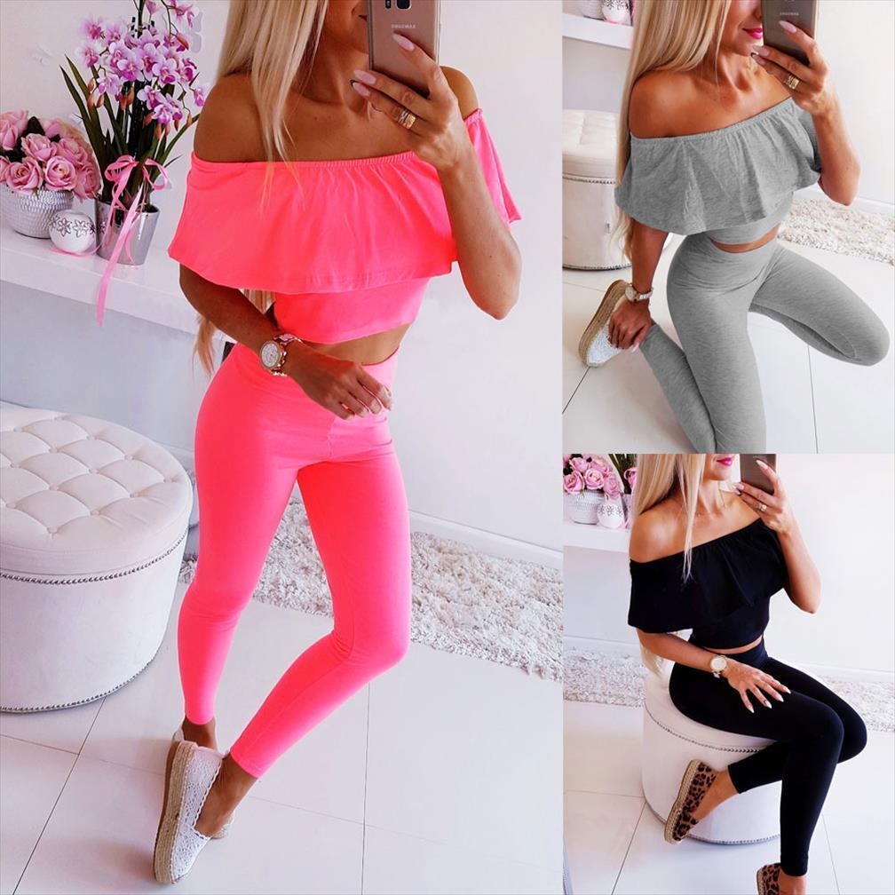 Neue beiläufige Art und Weise fest Volltonfarbe Sportanzug sexy trägerlos Wort Kragen kurzer Ärmel kurzes Hemd elastische Hose