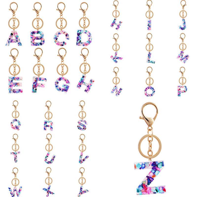 Ювелирные изделия Ключ цепи алфавит цепочки ключей кольцо 26 Английский Начальные буквы Имя брелки Автомобильные Уолтовые сумки Аксессуары 100 шт. T1i2533
