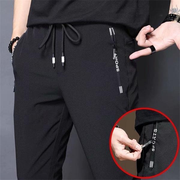 Лето Thin Men Спорт Мужчины Повседневная Корейский Эластичность Ножки Quick Dry Pants Straight Марка Деловой костюм Брюки Q1110