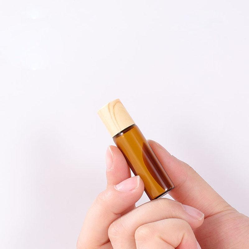 1ml 2ml 3ml 5ml Mini Roller Ball Bottles For Essential Oil Perfumes Oil Roll On Glass Bottle With Plastic Wooden Grain Cap