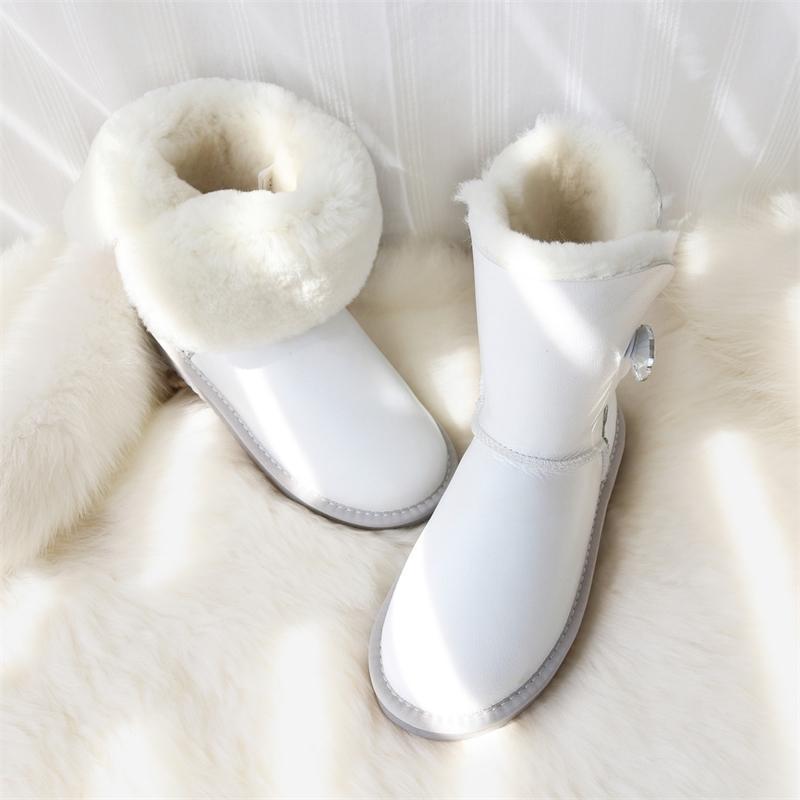 Botas de nieve Mujeres de piel de oveja genuina Zapatos de piel a prueba de agua Botas de lana de ovejas a prueba de agua Piel Mid-becerro plano hembra zapatos de invierno 201027
