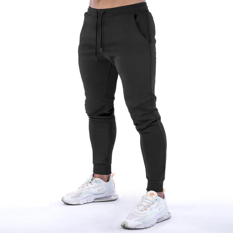 Pantaloni Casual primavera e in autunno Uomo Slim Trend corsetto fitness Sweatpants Streetwear Pantaloni a vita alta Donne