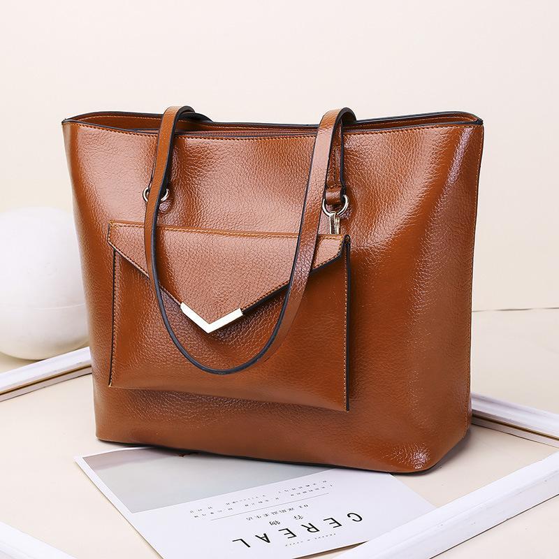 Luxurys Конструкторы сумки Женская сумка европейских и американских женщин способа удерживания руки Big Bag Простая сумка плеча Модные Tote