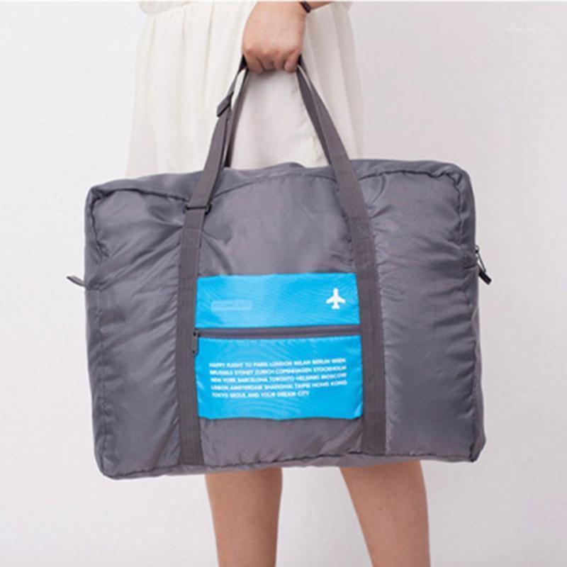 Bolsa de viaje impermeable Organizador de equipaje plegable para mujeres Hombres Tote portátil Bolsa de hombro de gran capacidad Duffel Embalaje Handbag1