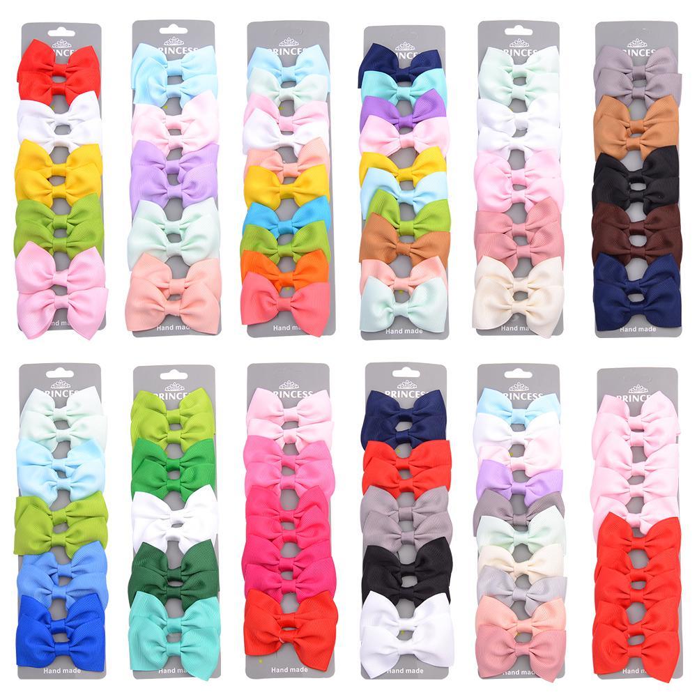 10 pièces / set ruban gros-grain Bows cheveux avec clip pour Mignon Bébés filles colorés Barrettes épingles à cheveux Barrettes enfants Accessoires cheveux