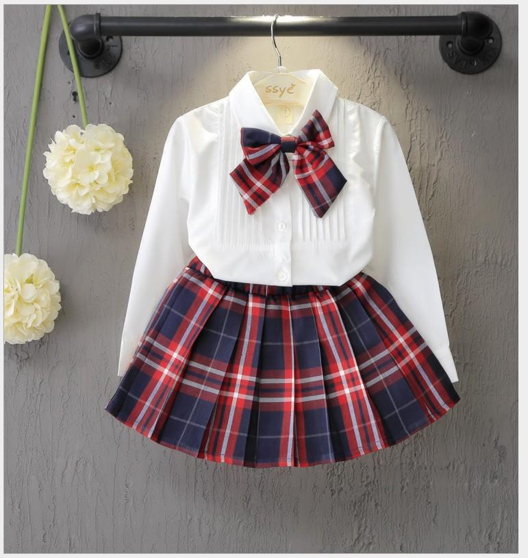 New Arrivals Roupa Bebés Meninas Define Branca manga comprida camisa com gravata borboleta + Plaid saias 2pcs Suit Set menina Roupas Crianças