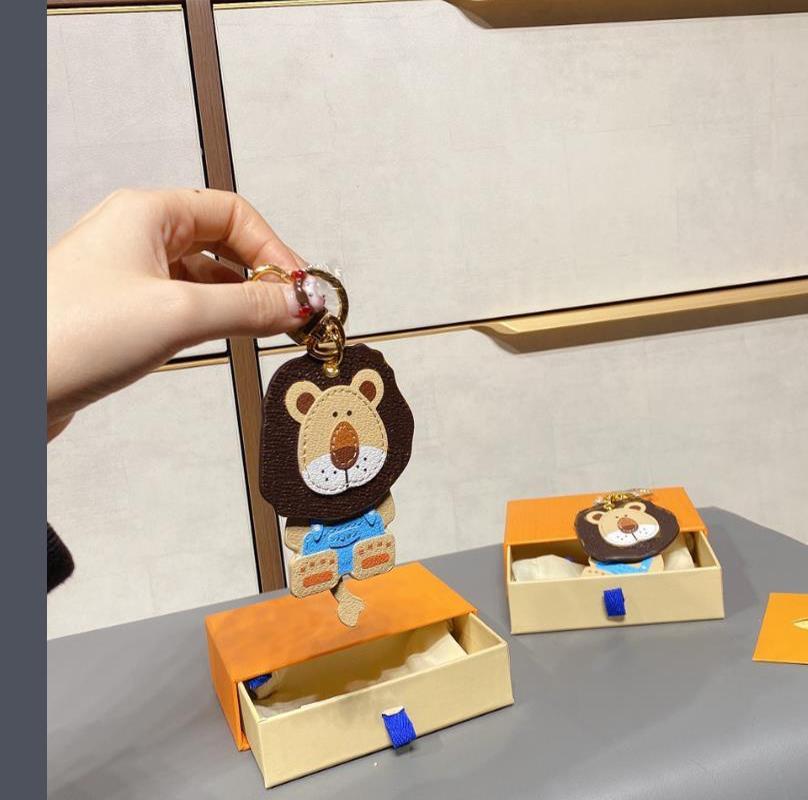 Borsa in stile Lion Zipper Fibbia Uomo Donna Borsa Borsa Accessori Moda Biglietto di Moda Fibbia Auto Keychain Portachiavi in pelle fatti a mano Portachiavi 2 colori