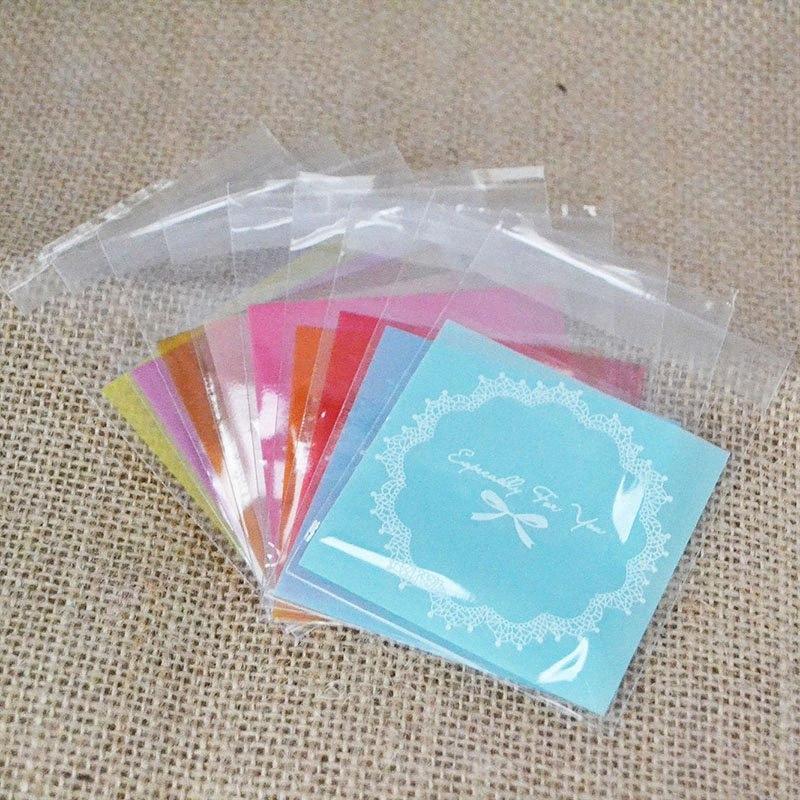 50 adet 7 * 7cm Çok renkli Plastik Dantel Çelenk Çanta Şeker Kurabiye Hediye Çanta Buzlu OPP doğum günü partisi Şeker Packaging Irgx #