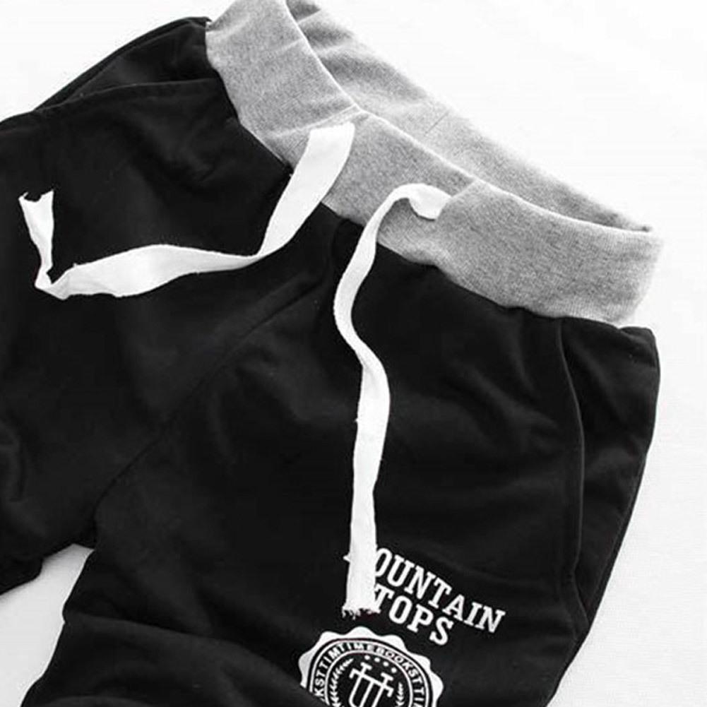 Hommes Shorts Summer Beach Lâche Court Man Gym Fitness Longueur du genou Longueur respirante Pant à coton Fashion Casual pour l'extérieur