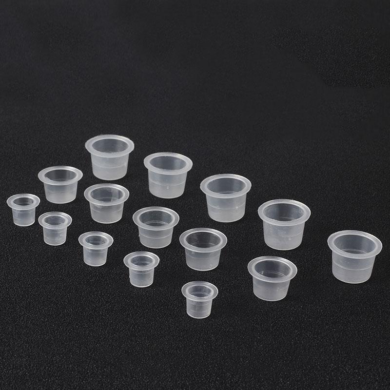 جديد 1000PCS S / M / L ماكياج البلاستيك القابل للتصرف Microblading حبر الوشم الكؤوس الدائم صبغات واضحة حامل الحاويات كاب الوشم ملحقات