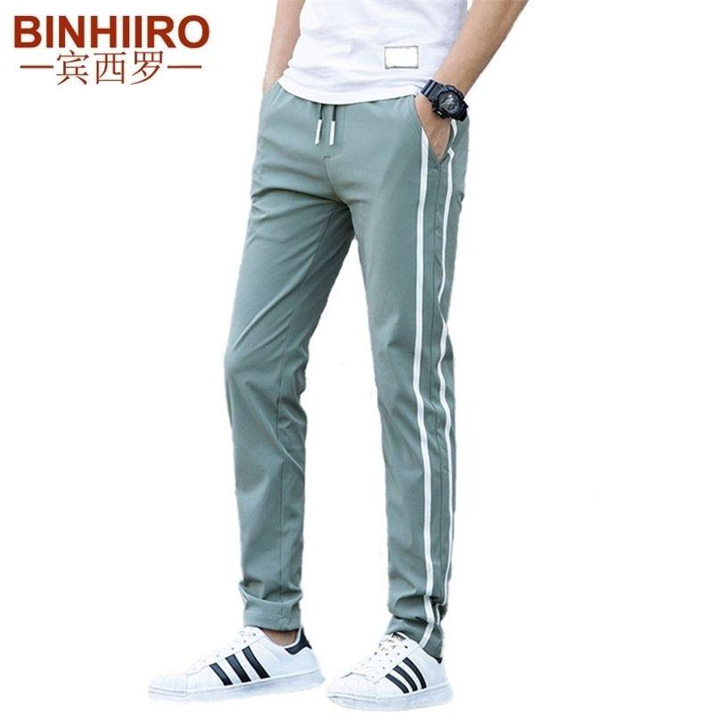 Pantalon décontracté pour homme de marque Mince Pantalons à rayures respirantes Nouveau Streetwear Slim Printemps et Summer Pantalon Casual Hommes 201118