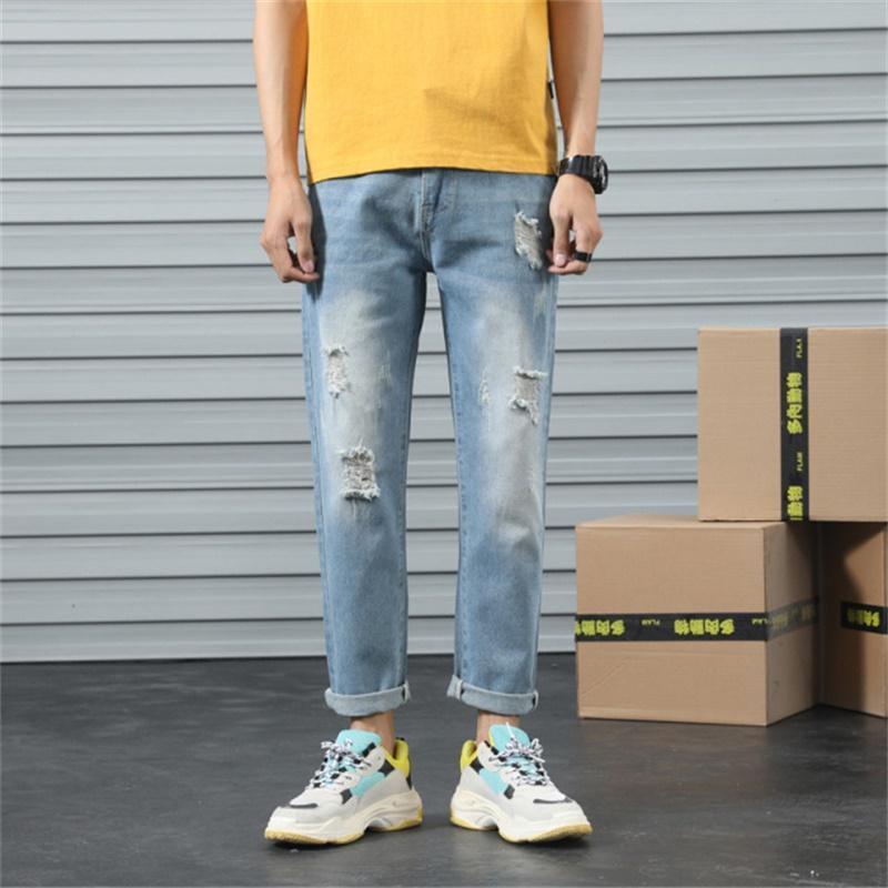 Envío gratis 2021 Verano Nuevo Rompeado Romificado Jeans Longitud Medio Rise Slim Stretch Retro Jeans Azul claro azul