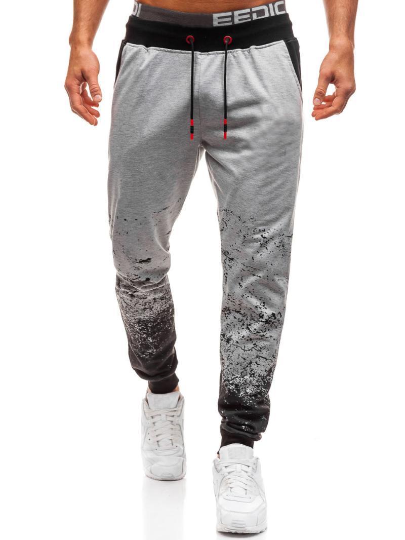 Mode Sweatpants Pantalons Hommes Couleur unie Dégradés Pantalons simple avec fil en vrac et un pantalon Streetwear joggeurs hommes Confortable