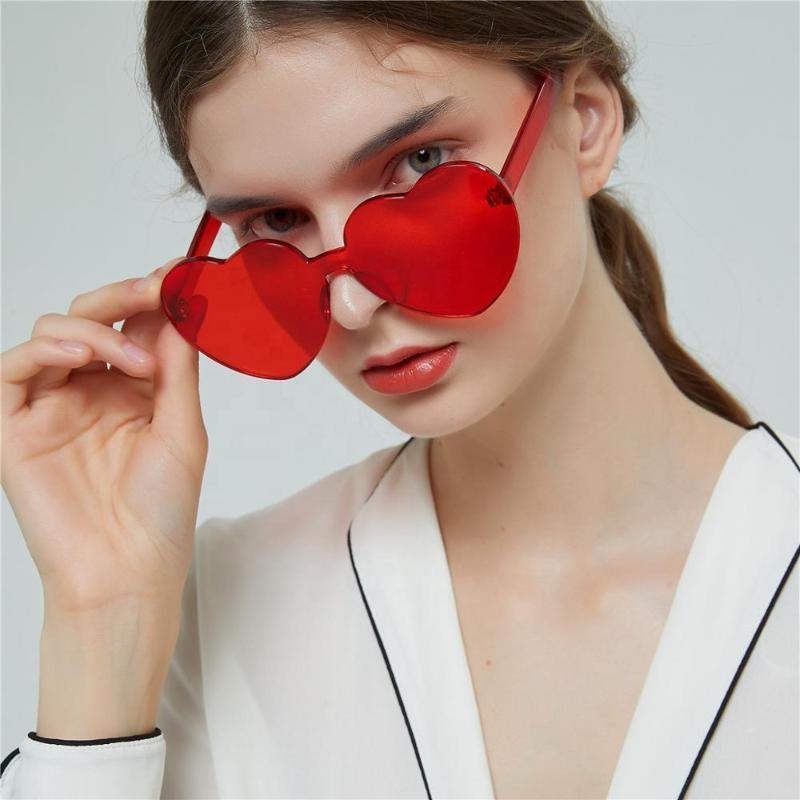 Bunte neue Form Randlose transparente rote Form Frauen Herz 90er Jahre Pfirsich Sonnenbrille Punk 2020 Hight Qualität Marke Ankunft UV400 UOGSP