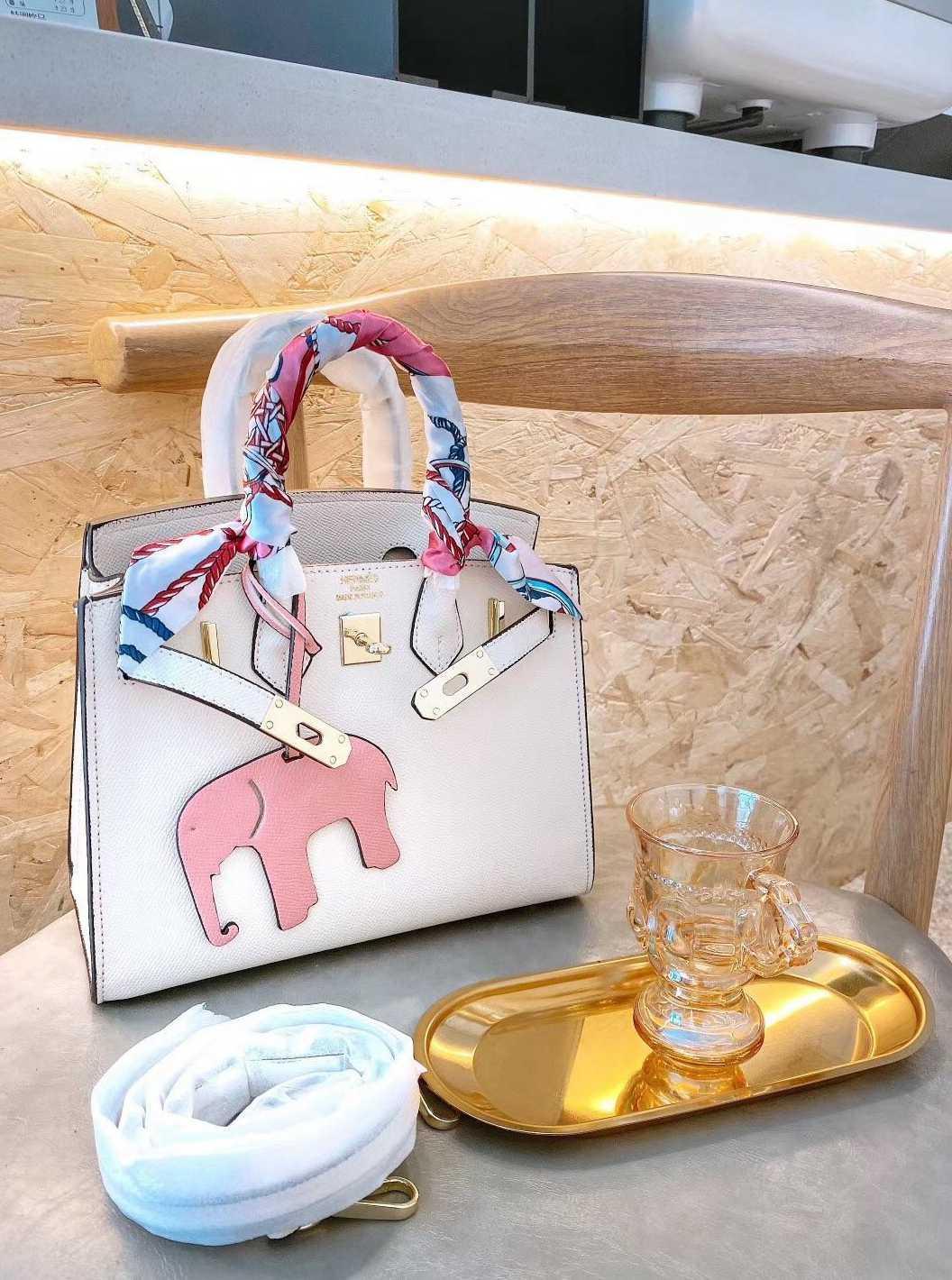 Sıcak satış Orijinal deri erkek ve kadın omuz çantası Messenger çanta omuz taşınabilir çantası sırt çantası -L0087