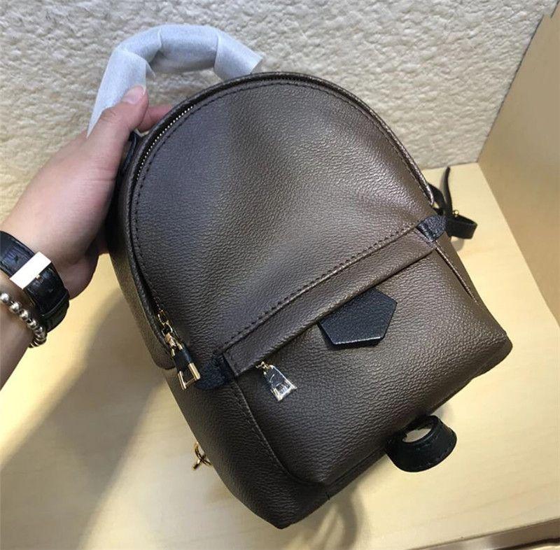Şık ladie / kız Ücretsiz nakliye için lüks tasarım En iyi kalite Kadın Mini Sırt Çantası Gerçek Deri Paim SPRlNGS çanta Esansiyel