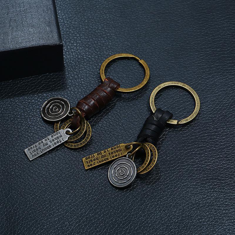 Accessori per la mano del ciondolo del ciondolo del ciondolo della catena chiave della catena di cuoio della pelle intrecciata