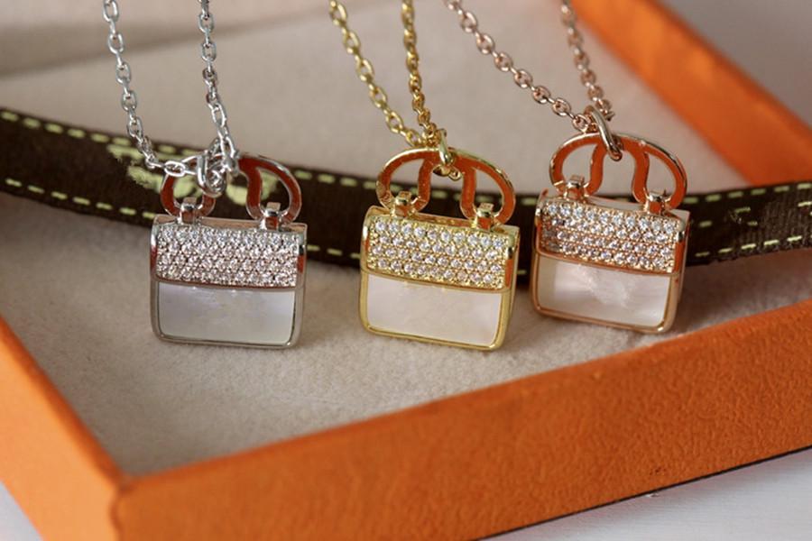 الجملة عالية الجودة الرجال النساء أزياء قلادة الماس مثلج من قلادة قلادة الفولاذ المقاوم للصدأ حقيبة نمط h رسالة مصمم قلادة