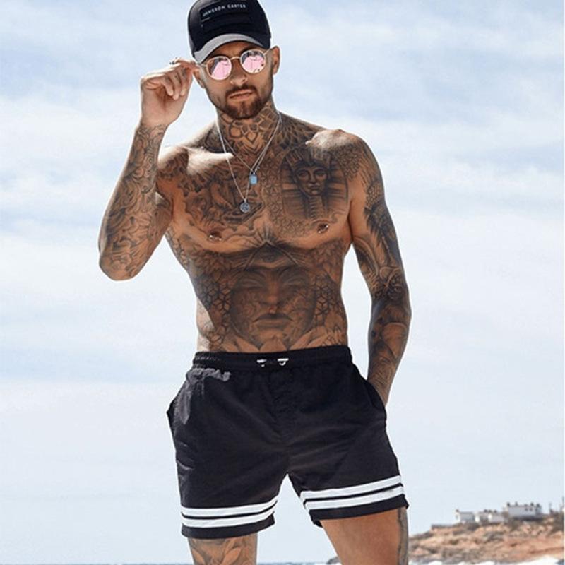 Nuevos hombres de moda deportivo Pantalones cortos de playa Pantalones para pantalones Bodybuilding Sweetpants Fitness Short Jogger Casual gimnasios Hombres Tamaño grande Shorts Y200401