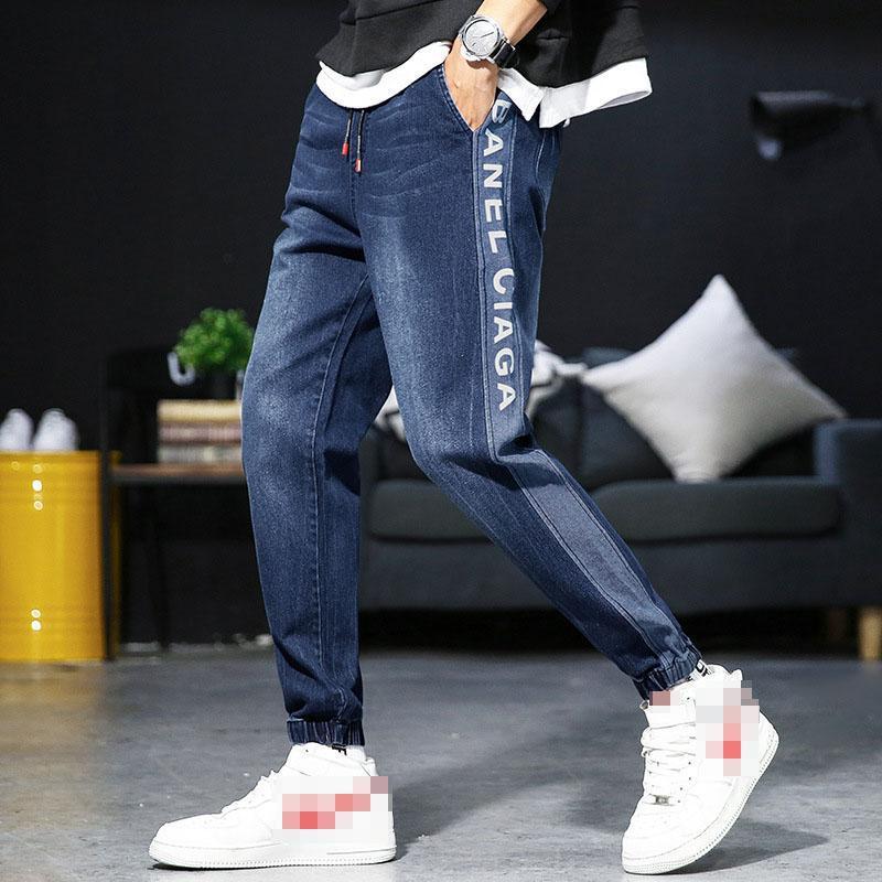 Мужские джинсы мужские повседневные лодыжки длина тонких джинсовых брюк твердого полоса буква пробежки карандаш высокие уличные брюки